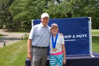 Sarah with the head professional at Augusta National, JJ Weaver.